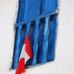 Upstairs Window and Flag, Cuzco, Peru