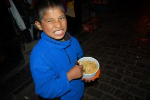 A Boy Happy Enjoying The Street Food