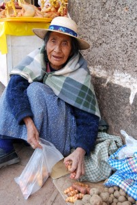 Lady Offering Oca and Potatoes For Sale