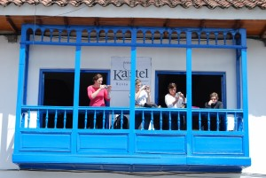 Tourists on a Balcony over the Plaza