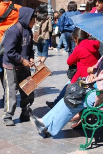 A Shoeshine Boy Asking to Clean Shoes on the Plaza