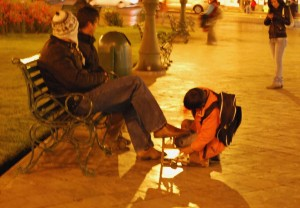 A Shoeshine Boy Working at Night