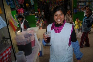 The Casera Offering Chicha Morada at the Market