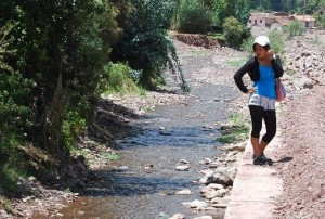 A Young Woman by a Stream in Cuzco
