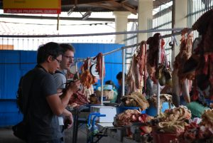 Tourists in the Meat Section of San Pedro Market
