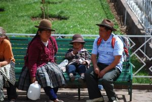 Family Sitting on a Bench in the Plaza of San Blas