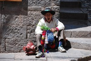 Yawning Man with Rue and Knitted Caps (Chullos) Hoping to Sell in the Street