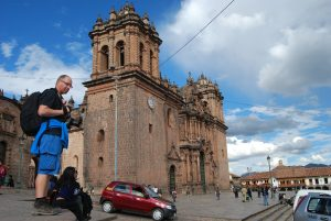 Cuzco's Cathedral with a Tourist by Its Side
