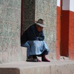 Older Woman of Cuzco Warming Herself in the Sun