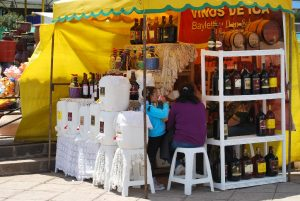 Selling Wine from Ica at a Fair in Cuzco