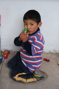 A Little Boy Playing with His Toys