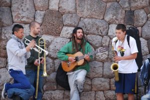 Mochileros Busking in the Streets of Cuzco