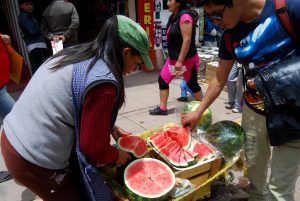 Slicing Watermelon for Sale on Cuzco's Streets