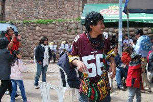 An Asian Tourist Dancing and Participating in Carnival