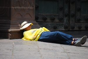 A Tourist Resting in the Doorway of the Cathedral