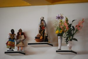 Saints, Dancers, and Flowers on the Wall of La Cusqueñita Picantería