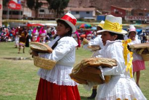 Cuzco Women Dancing with Chuta Bread