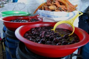 Olives in Big Vats in the Market