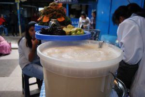 A Bucket of Refreshing Chicha Blanca in the Market