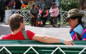 A Cuzqueña and a Tourist Conversing on the Plaza