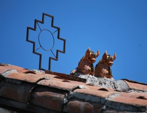 The Chacana next to Cuzco's Traditional Bulls on a Rooftop