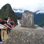 People Take Energy from the Inti Huatana at Machu Picchu