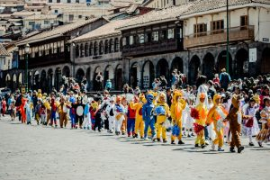 Lines of costumed children navigate the central square (Photo: Arnold Fernandez)