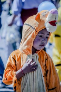 A boy dresses as Winnie the Pooh as part of the children's parade in central Cuzco. (Photo: Brayan Coraza)