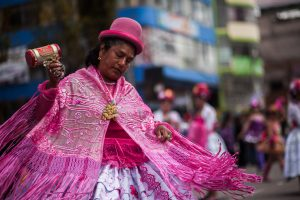 A dancing Morenada in the indigenous urban dress of the area.