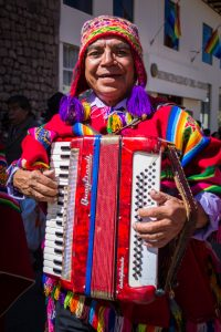 A Cusqueño Man Playing His Accordion