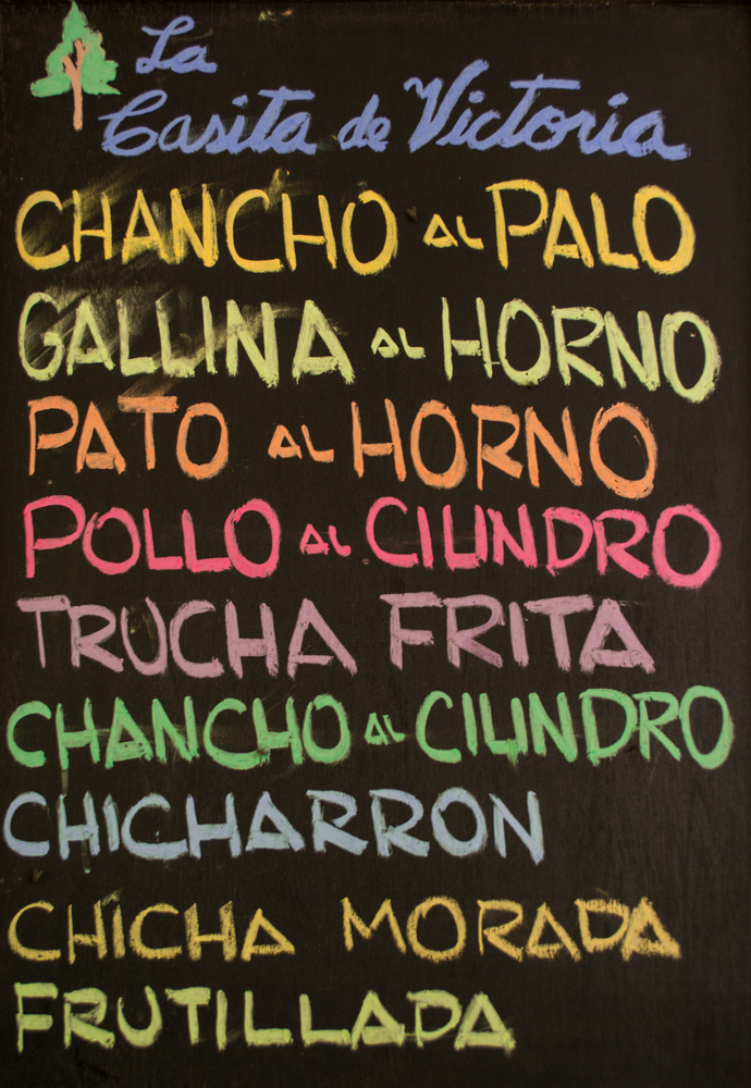 A Chalked Sign in Lamay Offering Various Dishes (Brayan Coraza Morveli)