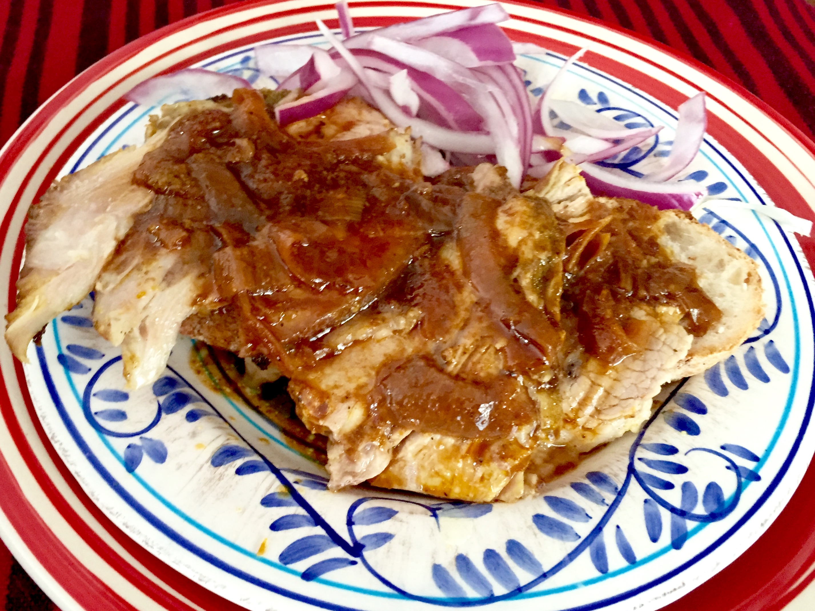 Open Face Lechón Sandwich with Gravy and Peruvian Onion Zarza (David Knowlton)